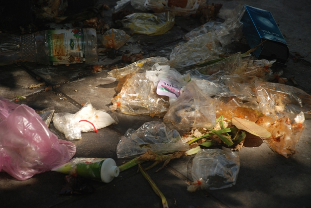 Bangkok street rubbish by Claire Rosslyn Wilson